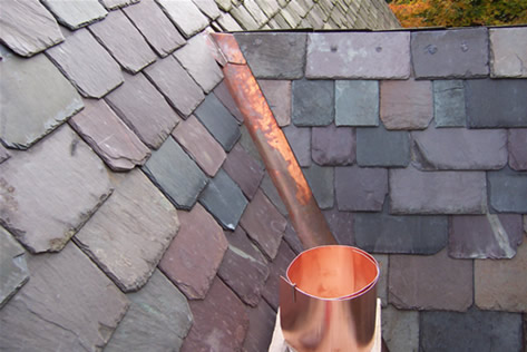 Graduated slate roof with custom soldered copper valley